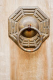 Chinese ancient bronze lock with octagon style. Royalty Free Stock Photo