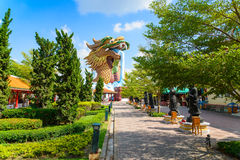 Chinese ancient buildings and golden dragon sculpture at Pillar Royalty Free Stock Photo
