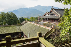 Chinese ancient buildings outside lichen-covered stone balustrad Stock Photography