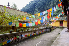 Chinese ancient buildings with praying flags in mountain Stock Photo