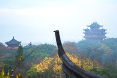 Chinese ancient buildings tower. A piece of the roof in the foreground Royalty Free Stock Photo