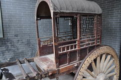 Chinese ancient carriage. In Chinese ancient carriage, whole wooden structure, the carriage can take two to three people is full of artistic feeling Royalty Free Stock Photography