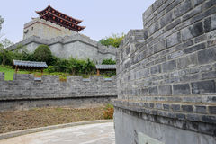 Chinese ancient defensive wall with gate tower on mountaintop Stock Photography