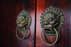 Door knocker. Chinese ancient door knocker, beast pattern plays a protective meaning, has now become less and less Stock Photo