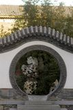 Chinese ancient garden fence. China`s ancient walls and round the door Stock Photo
