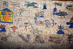 Chinese  ancient hieroglyph. Naxi nation is one of Chinese nations which lives in southwest China and they had ancient hieroglyph as these showing on a wall on Stock Images