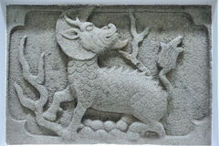Chinese ancient kylin stone carving Stock Photos