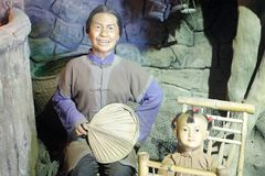 Chinese ancient south fujian family wax figure, adobe rgb. Chinese ancient south fujian grandmother and grandson wax figure. the period was about the nineteenth stock photos