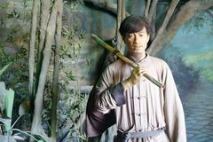 Chinese ancient south fujian man wax figure, adobe rgb. Chinese ancient south fujian man wax figure. the period was about early twentieth century. he is carrying stock photo