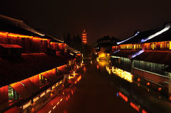 Chinese ancient town at night. The buildings nearby the river are so old but really beautiful royalty free stock photo