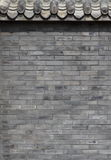The Chinese ancient wall. The ancient Chinese caesious brick wall with gate tower Royalty Free Stock Images