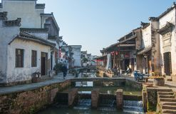 Chinese ancient water town with tradition step, house, culture and reflection. China old water village with traditional architecture building, street and life royalty free stock images