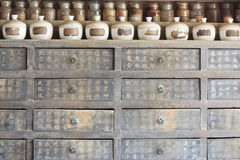 Chinese Antique medicine cabinet with bottles Royalty Free Stock Photos
