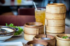Chinese appetizer, Dimsum, streamed cuisine on bamboo basket Royalty Free Stock Photo