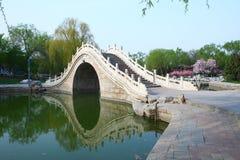 Chinese arch bridge in lake Royalty Free Stock Image