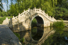 Chinese arch bridge. Stone Arch Bridge architecture developed from ancient times in China, and its compact shape and beautiful, it is subject to a lot of people Royalty Free Stock Photos