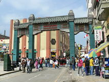 Chinese arch in Lima Chinatown and people walking Stock Photography
