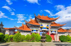 Chinese Arched  Entrance under Blue Sky and White Cloud. Colorful Arched Entrance of Chinese Temple under Blue Sky in Dali, Yunnan China Stock Image