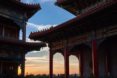 Chinese architecture with sunset background Stock Images