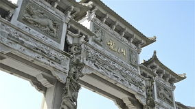 Chinese archway with stone carving zooming stock footage