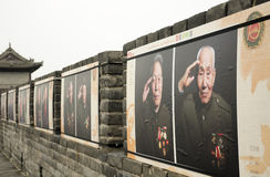 Chinese Armed Service Veterans Xian China. Decorated living and deceased Chinese servicemen decorating the Xian city wall in Shaanxi province China Royalty Free Stock Images