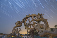 Chinese Armillary Sphere and Star trail Royalty Free Stock Photography