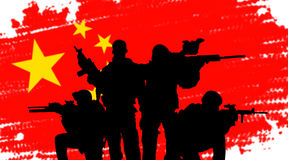 Chinese army soldiers concept. Chinese army soldiers silhouette concept on flag background Stock Photo