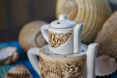 Chinese aroma lamp and sea shells Stock Photography