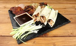 Chinese Aromatic Duck And Pancakes. Chinese aromatic roasted duck meat and pancakes meal royalty free stock images