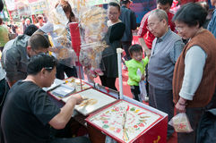 Chinese artists of painting with sugar Stock Photography