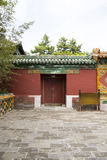 Chinese Asia, Beijing, Beihai Park, the ancient buildings, the red door and the wall Royalty Free Stock Image