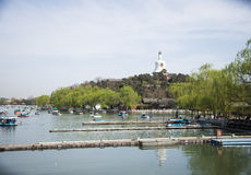 Chinese Asia, Beijing, the Royal Garden, Beihai Park, the ancient buildings, the White Pagoda Royalty Free Stock Image