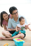 Chinese asian family playing on the beach Stock Photo