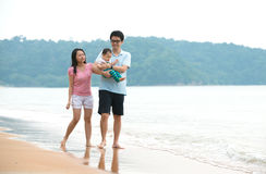Chinese asian Family walking On the Beach Stock Photography