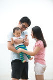 Chinese asian Family walking On the Beach Royalty Free Stock Photo