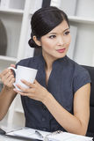 Chinese Asian Woman Businesswoman Drinking Tea or Coffee Stock Image