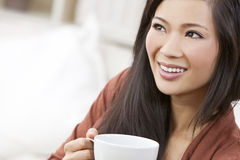 Chinese Asian Woman Drinking Tea or Coffee Stock Image