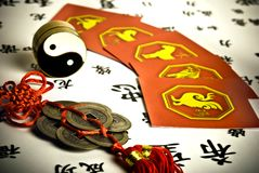 Chinese astrology. China lucky coins, yin yang, i-ching and astrological signs cards in old style with vignette royalty free stock photos