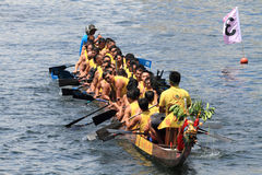 Chinese athletes on dragon boat Royalty Free Stock Images