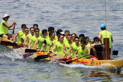 Chinese athletes participating in dragon boat competition Stock Images