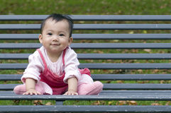 Chinese baby on the bench Royalty Free Stock Photos
