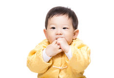 Chinese baby boy bite finger Royalty Free Stock Photos