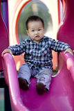 Chinese baby  boy in a children park Stock Photos