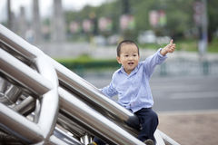 Chinese baby boy climb the ladder Stock Photography