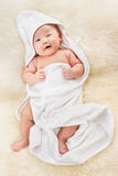 Chinese baby boy covered with white blanket Royalty Free Stock Photos