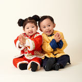 Chinese baby boy and girl in traditional Chinese New Year outfit Royalty Free Stock Photo