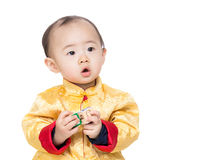 Chinese baby boy holding toy block Stock Image