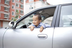 Chinese baby boy palying in the car Royalty Free Stock Photo