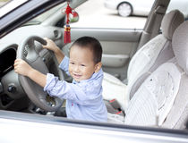Chinese baby boy palying in the car Stock Photos