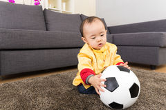 Chinese baby boy play soccer ball Royalty Free Stock Image
